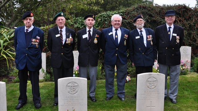 Survivors of the sinking of HMS Charybdis and Limbourne in 1943 attending the memorial service in 2012