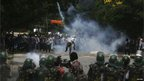 A pro-Telangana supporter throws a stone towards the riot police personnel during a protest in the southern Indian city of Hyderabad September 30, 2012