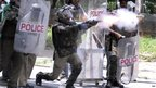 Indian police fire tear gas at members of the Telangana Students Joint Action Committe (TSJAC) at a rally in Hyderabad on 30 September 2012.