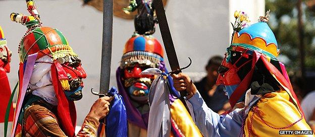 Participants perform the role of medieval Christian and Moorish warriors at the traditional Los Historiantes dance in San Miguel de Mercedes, El Salvador (Dec 2007)