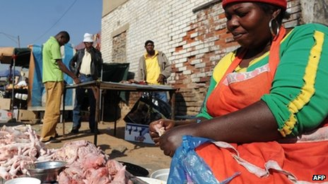 A street vendor selling chickens in Alexandra township outside Johannesburg