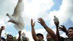 Indonesian people release white pigeons