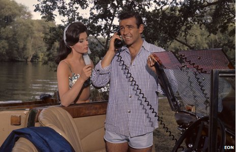 James Bond (Sean Connery) and Sylvia Trench's (Eunice Gayson) romantic encounter on the banks of the river is interrupted by a call from HQ