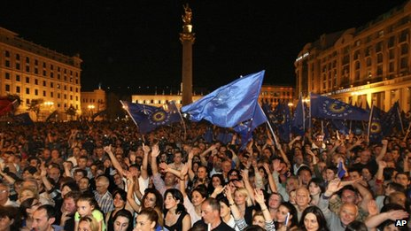 Opposition supporters celebrate in the central square during a rally in Tbilisi Georgia