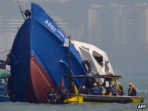 The bow of the Lamma IV boat (L) is seen partially submerged during rescue operations on 2 October