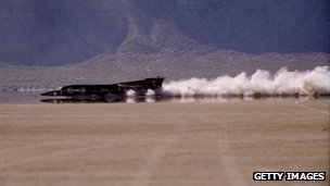 The Thrust SSC Land Speed Racer races down the Nevada desert floor as it sets the land speed record at Black Rock Desert in Nevada