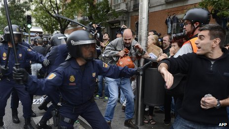 Riot police and demonstrators in Madrid