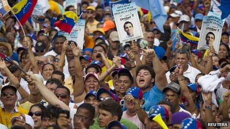 "Supporters of Venezuela""s opposition presidential candidate Henrique Capriles attend a campaign rally in La Guaira outside Caracas"
