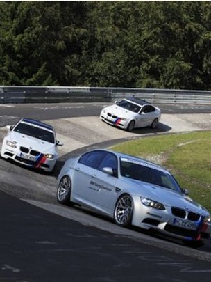 BMW models on a race track