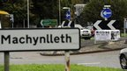 A sign post for Machynlleth, where April Jones is missing