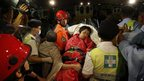 A survivor is taken ashore by rescuers on Hong Kong , 2 October 2012