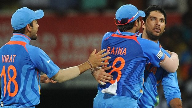 Yuvraj Singh celebrates taking a South African wicket with team-mates