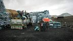 This handout photograph released by the African Union-UN Information Support Team shows sacks of charcoal by the roadside 