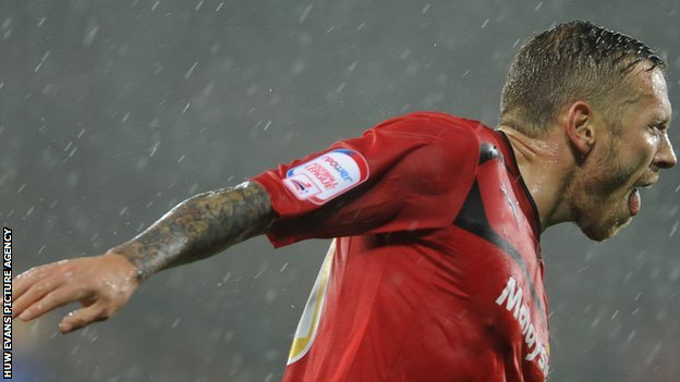 Craig Bellamy celebrates his opener