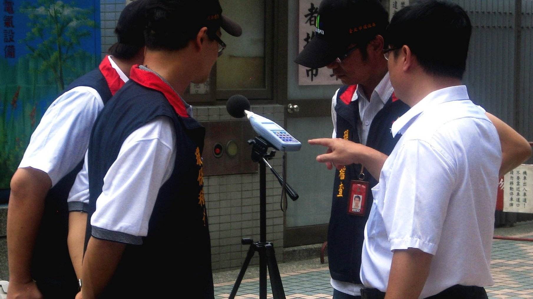 Inspectors from Taipei&#039;s Department of Environmental Protection read a sound level meter in Taipei, Taiwan, 16 July 2012