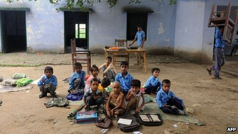 Indian school children read in an open air classroom at a government school in Bagpath district in Uttar Pradesh.