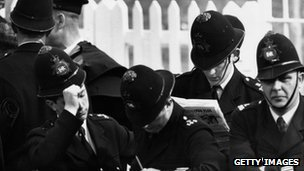 Police reading papers, 1958