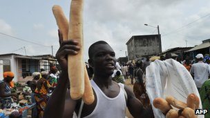 Bread seller in Abidjan, Ivory Coast