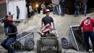 Workmen on Venezuela's government-backed house-building programme