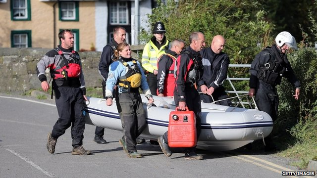 Search team with boat