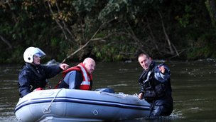 Search teams on the River Dyfi