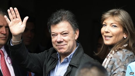Colombia's President Juan Manuel Santos arriving at a Bogota clinic, with his wife Maria Clemencia Rodriguez