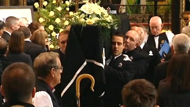 Police officers carrying Hughes' coffin into Cathedral