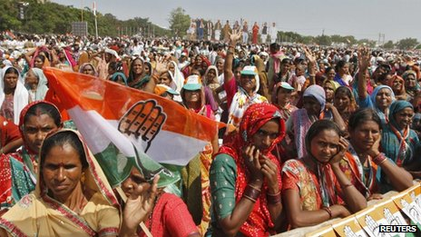 "Supporters of India""s ruling Congress party listen to the speech by party chief Sonia Gandhi during an election campaign rally ahead of state assembly elections at Rajkot, in the western Indian state of Gujarat October 3, 2012"