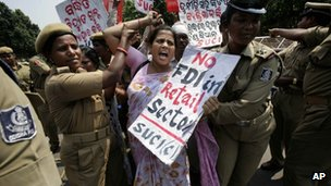 Police arrest an activist of SUCI as she shouts slogans against the government during a protest against economic reforms in the eastern Indian city of Bhubaneswar, India, Thursday, Sept. 27, 2012.