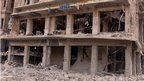The front of a damaged building, possibly a hotel, in Saadallah al-Jabri square in Aleppo, Syria, 3 October 2012