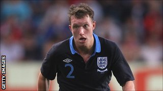 Manchester United midfielder Phil Jones in action for England