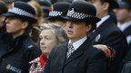 A member of the public comforts a police officer at the funeral of PC Fiona Bone