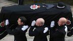 The coffin of PC Fiona Bone arriving at Manchester Cathedral