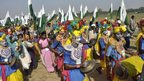 "Colourfully dressed marchers play traditional musical instruments as they begin ""Jan Satyagraha"""