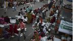 Marchers sit to eat a meal on the way to Delhi