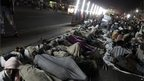 "Marchers sleep on a road at a halting point during ""Jan Satyagraha,"" from Gwalior to Delhi"