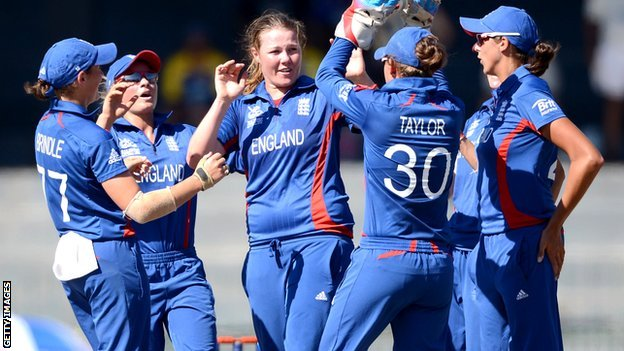 Anya Shrubsole celebrates with her England teammates