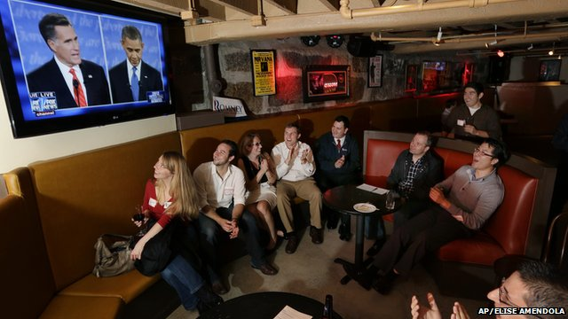 Members of the Massachusetts GOP Young Republicans react as they watch the first presidential debate