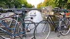 Bikes on a bridge crossing an Amsterdam canal