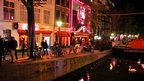 Amsterdam's red light district, beside a canal