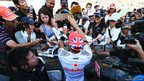 Lewis Hamilton of Great Britain and McLaren signs autographs for fans