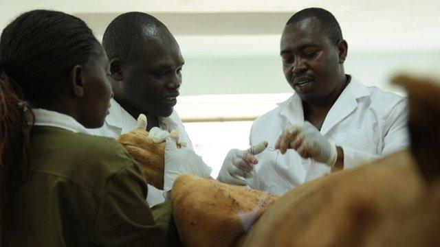 Dr Edward Kariuki (right)