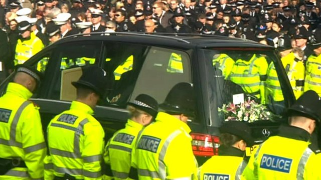 Lines of police bowing their heads as PC Nicola Bone's coffin passes