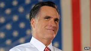 US Republican presidential candidate Mitt Romney reacts to his supporters cheering during campaign rally on October 4, 2012 in Fishersville, Virginia.