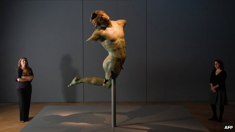 Bronze statue entitled &quot;dancing satyr&quot;