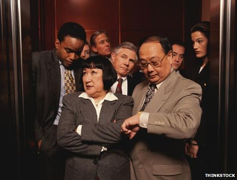 Eight people squeezed in a lift