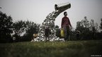 Visitors look at a sculpture created by Indian artist Subodh Gupta