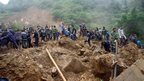 Rescuers search for victims after a landslide