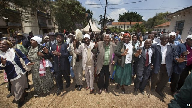 Kenyan Mau Mau war veterans and their supporters celebrate