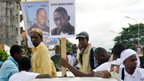 Placards are held up of two people killed in recent clashes in Guinea's capital, Conakry - Friday 28 September 2012